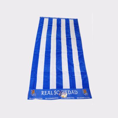 Errealeko hondartzarako toalla marraduna.  100% kotoia.  Neurria: 90 x 170 cm.